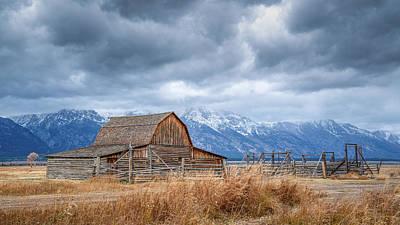 Clouds Royalty Free Images - The T. A. Moulton barn, the Tetons obscured by clouds. Royalty-Free Image by Chris Allmendinger