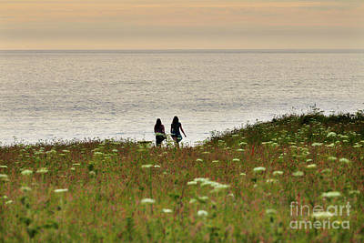 Clouds Rights Managed Images - Walking at Sunset Royalty-Free Image by Terri Waters