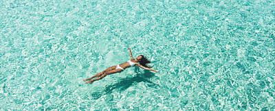 Royalty-Free and Rights-Managed Images - Woman in white bikini lying on transparent turquoise water surface on beach. Travel and vacations concept. Tropical background with empty space by Julien