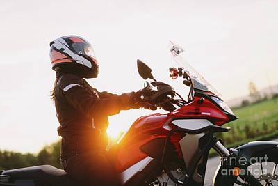 Impressionist Landscapes - Woman riding motobike at sunset by Michal Bednarek