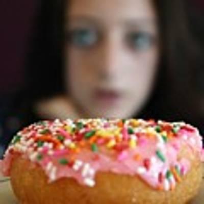 Girl With Doughnut Art Print