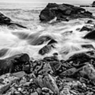 Waves Against A Rocky Shore In Bw Art Print by Doug Camara