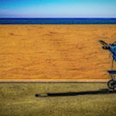 Stroller At The Beach Art Print by Paul Wear