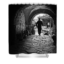 Shower Curtain featuring the photograph Man In An Archway / Hammamet by Barry O Carroll