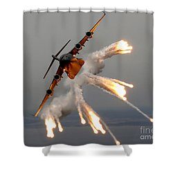 Shower Curtain featuring the photograph A C-17 Globemaster IIi Releases Flares by Stocktrek Images