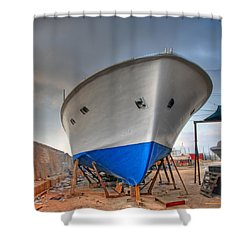 Shower Curtain featuring the photograph a resting boat in Jaffa port by Ron Shoshani