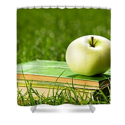 Apple On Pile Of Books On Grass Shower Curtain by Michal Bednarek