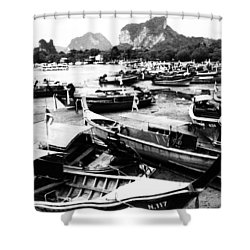 Beached Longboats Shower Curtain by Justin Woodhouse