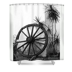 Shower Curtain featuring the photograph Broken Wheel by PJ Boylan