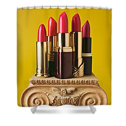 Five Red Lipstick Tubes On Pedestal Shower Curtain by Garry Gay