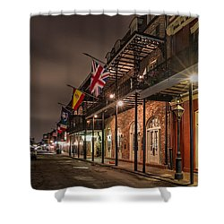 Shower Curtain featuring the photograph French Quarter Flags by Tim Stanley