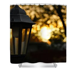 Shower Curtain featuring the photograph Lamplight by Photographic Arts And Design Studio
