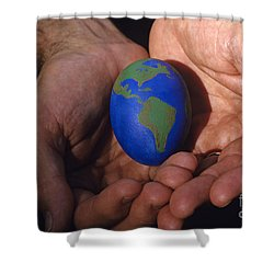 Man Holding Earth Egg Shower Curtain by Jim Corwin