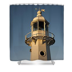 Mevagissey Lighthouse In The Evening Shower Curtain by Anne Gilbert