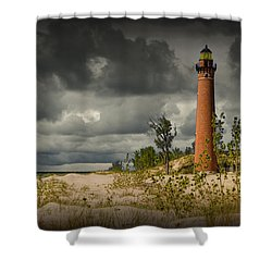 storm clouds passing the little sable point lighthouse shower curtain