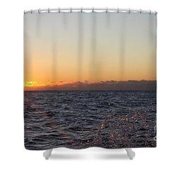 Sun Rising Through Clouds In Rough Waters Shower Curtain by John Telfer