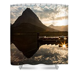 Swiftcurrent Lake Boats Reflection And Flare Shower Curtain by John Daly
