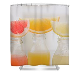 Three Fruit Juices In Bottles With Wedges Of Fresh Fruit Shower Curtain