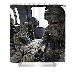 U.s. Army Flight Medics Aid A Simulated Shower Curtain by Stocktrek Images
