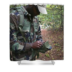 A Military Technician Uses A Pda Shower Curtain by Michael Wood