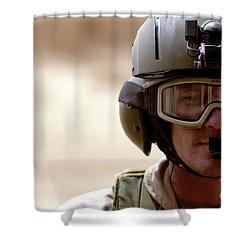 A Pararescueman Checks Shower Curtain by Stocktrek Images