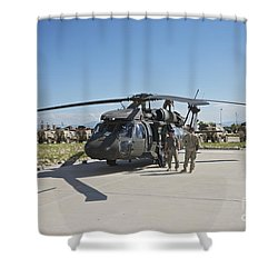 A Uh-60l Blackhawk Parked On Its Pad Shower Curtain by Terry Moore