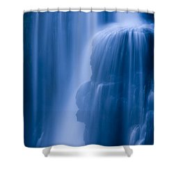 A Waterfall Splashes Off Of A Large Shower Curtain