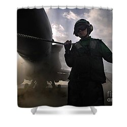 Airman Holds Up The Safety Shot Line Shower Curtain by Stocktrek Images