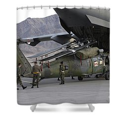 Airmen Load An Hh-60 Pave Hawk Shower Curtain by Stocktrek Images