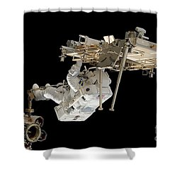 An Astronaut With His Feet Secured Shower Curtain by Stocktrek Images