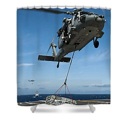 An Mh-60s Sea Hawk Helicopter Lowers Shower Curtain by Stocktrek Images