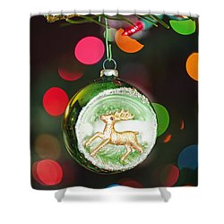 An Ornament With A Reindeer Hanging Shower Curtain by Craig Tuttle