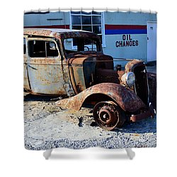 Shower Curtain featuring the photograph ...and Rotate The Tires by Larry Bishop
