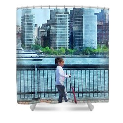 Little Girl On Scooter By Manhattan Skyline Shower Curtain by Susan Savad