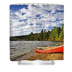 Red Canoe On Lake Shore Shower Curtain by Elena Elisseeva