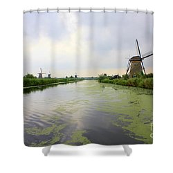 Reflection Of Sky At Kinderdijk Shower Curtain by Carol Groenen