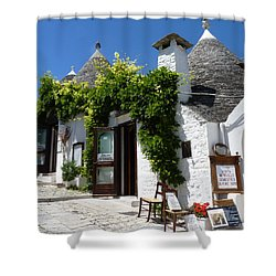 Street Scene In Alberobello Shower Curtain by Carla Parris