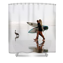 Shower Curtain featuring the photograph Surfers And A Pelican by Alice Gipson
