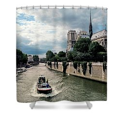 Shower Curtain featuring the photograph Tour Boat Passing Notre Dame by Dave Mills