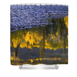 Water Reflections With A Rocky Shoreline Shower Curtain by Carson Ganci