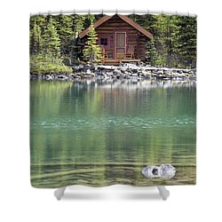 Wooden Cabin Along A Lake Shore Shower Curtain by Michael Interisano