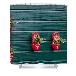 Shower Curtain featuring the digital art Wooden Shoes On Teh Wall by Carol Ailles