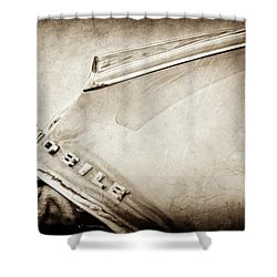 Shower Curtain featuring the photograph 1962 Oldsmobile Hood Ornament And Emblem -0598s by Jill Reger