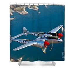 Shower Curtain featuring the photograph A Lockheed P-38 Lightning Fighter by Scott Germain