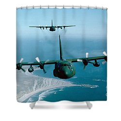 Shower Curtain featuring the photograph A Pair Of C-130 Hercules In Flight by Stocktrek Images