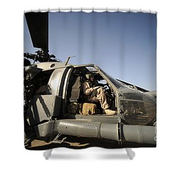 A Pilot Sits In The Cockpit Of A Hh-60g Shower Curtain by Stocktrek Images