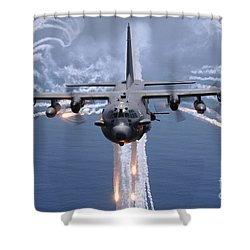 Shower Curtain featuring the photograph An Ac-130h Gunship Aircraft Jettisons by Stocktrek Images