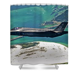 Shower Curtain featuring the photograph An F-35 Lightning II Flies Over Destin by Stocktrek Images