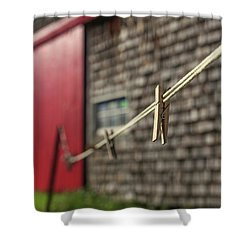 Shower Curtain featuring the photograph Clothes Pins On A Clothes Line At An Old Farm by Edward Fielding