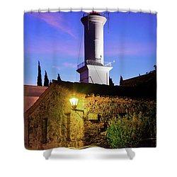 Shower Curtain featuring the photograph Colonia Lighthouse by Bernardo Galmarini